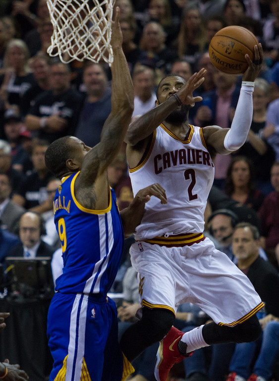 . Kyrie Irving of the Cleveland Cavaliers goes up against Andre Iguodala during game 4 of the NBA Finals against the Golden State Warriors at the Quicken Loans Arena on June 10, 2017.  The Cavs defeated the Warriors 137-116.