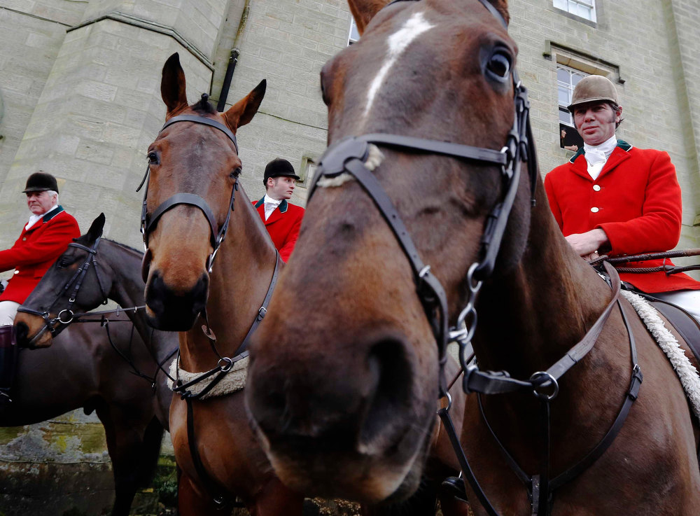 . Riders with the Old Surrey Burstow and West Kent Hunt wait at Chiddingstone Castle before the annual Boxing Day hunt in Chiddingstone, south east England December 26, 2012. A ban imposed seven years ago states that foxes can be killed by a bird of prey or shot but not hunted by dogs. Hunts continue nowadays with pursuers accompanying dogs in chasing down a pre-laid scented trail.  REUTERS/Luke MacGregor