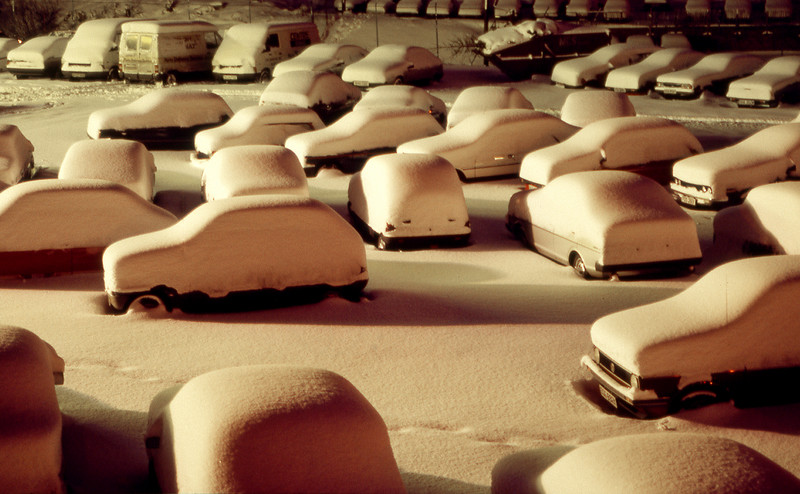 Used car lot after the Big Snow of January 1987.  Shields Road, Glasgow  In the second week of January 1987 there was exceptionally cold air over the near continent, and a depression centred on the English Channel brought strong easterly winds to the whole country. There was heavy snowfall all along the east coast, up to 20 inches, but the west largely escaped this - except that the wind was able to funnel through the Forth - Clyde Valley, and on the morning of Monday 12th it dumped the heaviest fall of snow that I can remember in Glasgow. The city was effectively paralysed, even the motorways beyond saving, and not much moved that day.