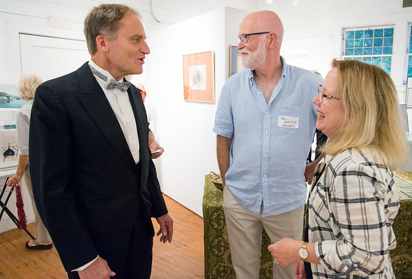 09/06/19 Wesley Bunnell | StaffrrThe Art League of New Britain held an opening show for artist Ned Lomerson on Friday September 6, 2019. Lomerson, L, speaks with President of ALNB Paul Baylock .