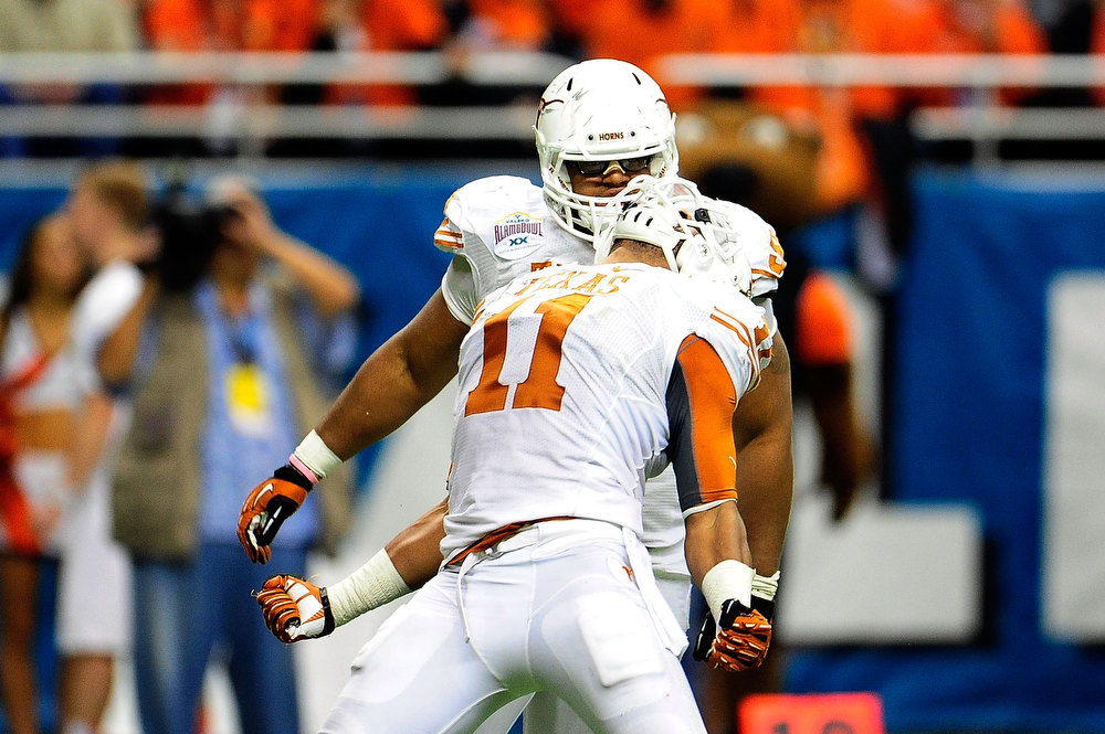 . Tevin Jackson #11 of the University of Texas Longhorns celebrates a sack against the Oregon State Beavers during the Valero Alamo Bowl at the Alamodome on December 29, 2012 in San Antonio, Texas.  Texas won the game 31-27.  (Photo by Stacy Revere/Getty Images)