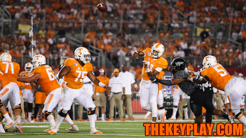 DE Ken Ekanem just misses on hitting Vols QB Joshua Dobbs as he fires off a pass in the third quarter. (Mark Umansky/TheKeyPlay.com)