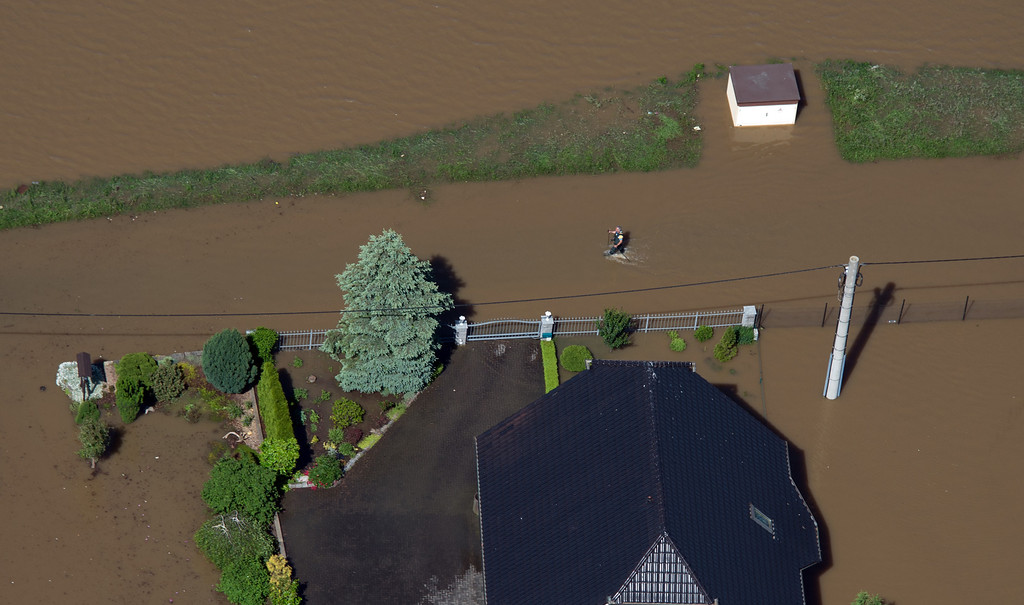 . Aerial view shows a man walking through the flooded streets of Goehlis, eastern Germany on June 5, 2013.  AFP PHOTO / JOHANNES  EISELE/AFP/Getty Images
