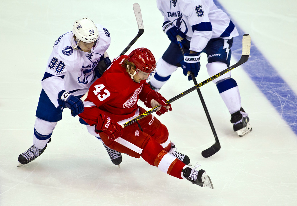 . Tampa Bay Lightning forward Vladislav Namestnikov (90), of Russia, collides with Detroit Red Wings forward Darren Helm (43) as they go for the puck during the third period of an NHL hockey game in Detroit on Sunday, Nov. 9, 2014. Tampa Bay won 4-3 in a shootout. (AP Photo/Tony Ding)