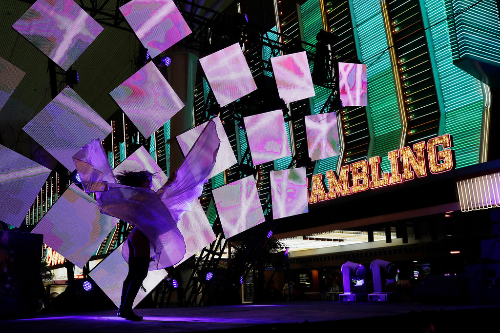 . A dancer performs on stage during a New Year\'s eve celebration Saturday, Dec. 31, 2016, in Las Vegas. (AP Photo/John Locher)