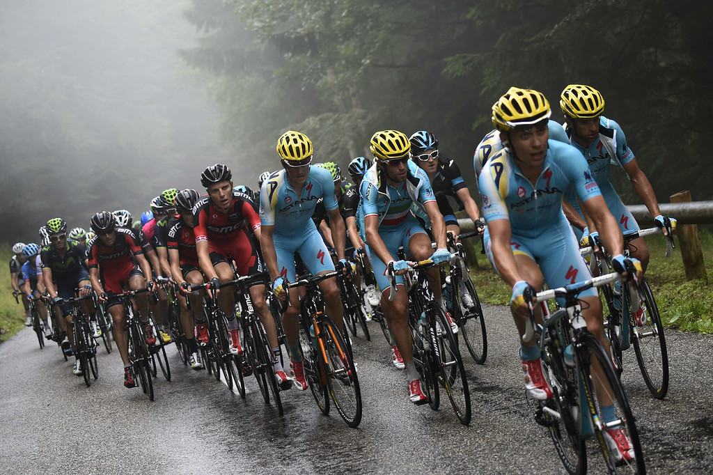 . Italy\'s Vincenzo Nibali rides with his Astana teammates in the pack during the 161.50 km tenth stage of the 101st edition of the Tour de France cycling race on July 14, 2014 between Mulhouse and La Planche des Belles Filles ski resort, eastern France.  AFP PHOTO / ERIC FEFERBERG/AFP/Getty Images