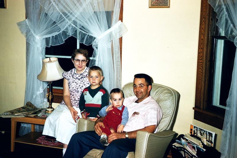 Clifford Larson & Family - Maretta, Chuck, Mark, Cliff. September 1956.  Slide 129.