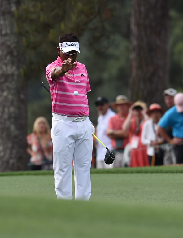 . Thongchai Jaidee of Thailand takes a ball drop on the 1st hole fairway during Round 4 of the 79th Masters Golf Tournament at Augusta National Golf Club on April 12, 2015, in Augusta, Georgia. DON EMMERT/AFP/Getty Images