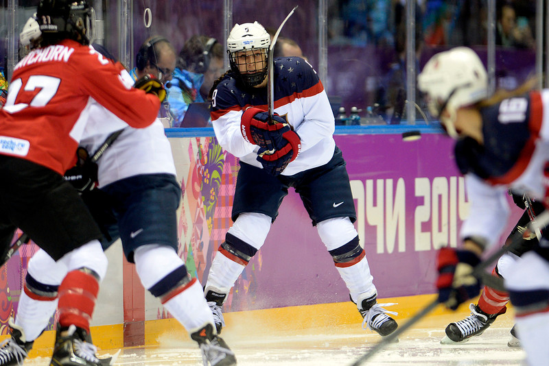 . Megan Bozek (9) of the U.S.A. flips the puck against team Canada during the first period of the women\'s gold medal ice hockey game. Sochi 2014 Winter Olympics on Thursday, February 20, 2014 at Bolshoy Ice Arena. (Photo by AAron Ontiveroz/ The Denver Post)