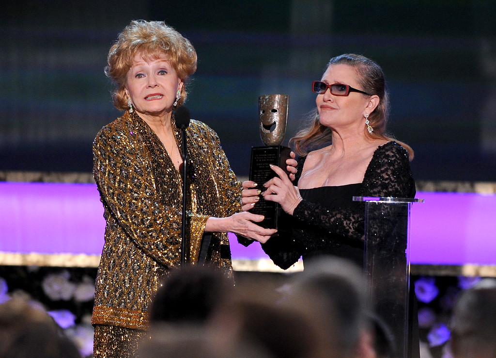 . Carrie Fisher, right, presents Debbie Reynolds with the Screen Actors Guild life achievement award at the 21st annual Screen Actors Guild Awards at the Shrine Auditorium on Sunday, Jan. 25, 2015, in Los Angeles. (Photo by Vince Bucci/Invision/AP)