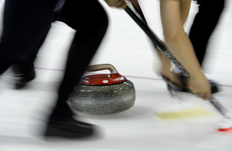 . Payers clear the way for the stone during the women\'s curling round robin session 2 at the Ice Cube curling centre in Sochi on February 11, 2014 during the 2014 Sochi winter Olympics. (JONATHAN NACKSTRAND/AFP/Getty Images)