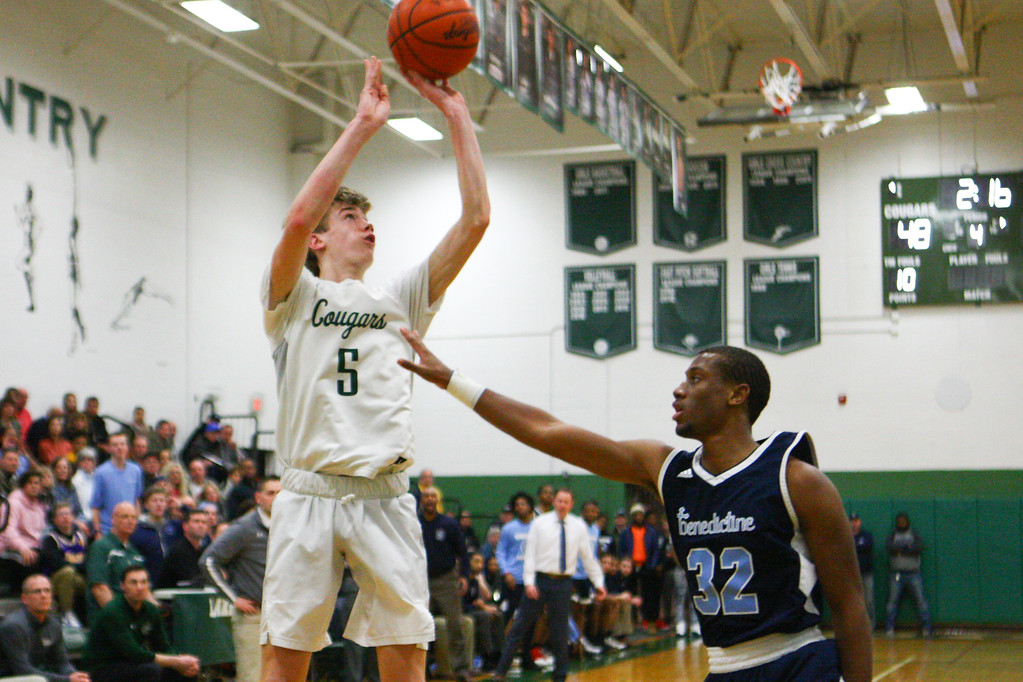 . 2018 - Basketball - Benedictine at Lake Catholic.  Benedictine defeated Lake Catholic 63-56.  Lake Catholic\'s Luke Frazier (5) puts up a three-pointer against Benedictine\'s Chris Jefferson (32).