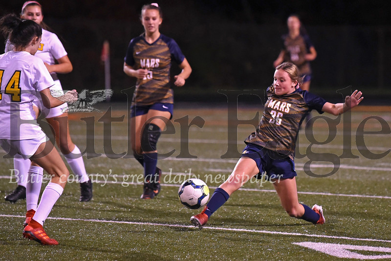 Mars freshman Julia Gagnon extends to pass the pall forward and counter a Thomas Jefferson push downfield. Gagnon scored the Planets final goal securing a 7-0 victory over the Jaguars Thursday. Seb Foltz/Butler Eagle