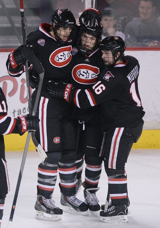 . DENVER, CO. - JANUARY 10: Jonny Brodzinski, center, had the final Husky goal of the night, late in the third period. The St. Cloud State hockey team defeated the University of Denver 6-3 at Magness Arena Friday night, January 10, 2014. Photo By Karl Gehring/The Denver Post