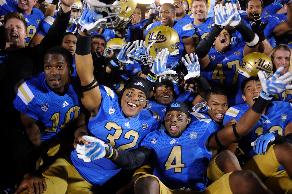 . UCLA players celebrate their victory over USC at the Los Angeles Memorial Coliseum Saturday, November 30, 2013.  UCLA beat USC 35-14. (Photo by Hans Gutknecht/Los Angeles Daily News)