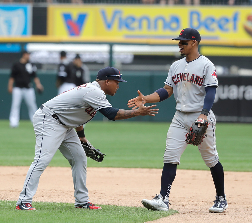 . Cleveland Indians\' Jose Ramirez, left, and Francisco Lindor celebrate the team\'s 5-2 win over the Chicago White Sox after a baseball game Thursday, June 14, 2018, in Chicago. (AP Photo/Charles Rex Arbogast)