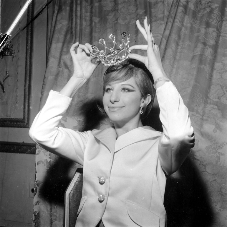 . Barbra Streisand poses after being crowned Miss Ziegfeld of 1965 at the Ziegfeld Club Ball at New York\'s Waldorf Astoria Hotel on Nov. 20, 1964.  (AP Photo/Marty Lederhandler)