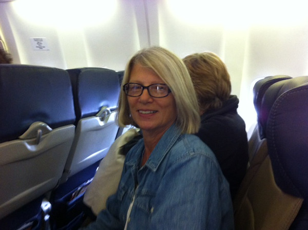 On the plane and on her way!