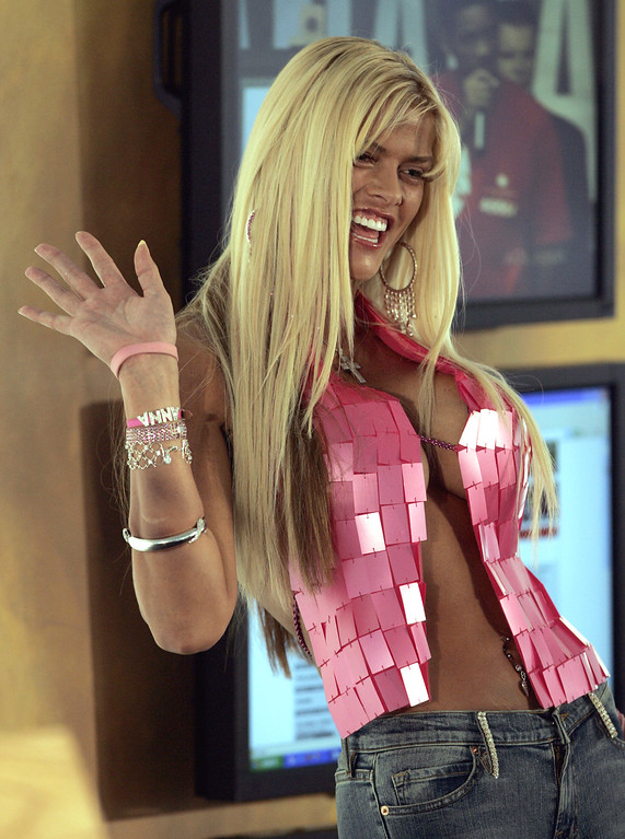 . **FILE**Anna Nicole Smith waves during an appearance backstage during the Live 8 concert in Philadelphia, on July 2, 2005. Smith, the former Playboy playmate whose bizarre life careened from marrying an octogenarian billionaire to the untimely death of her son, died Thursday, Feb. 8, 2007, after collapsing at a South Florida hotel, one of her lawyers said. (AP Photo/Coke Whitworth)