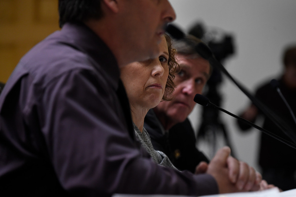 . DENVER, CO. - March 09, 2015: Jane Dougherty, who\'s sister that was killed at the Sandy Hook Elementary School shooting in Newtown, Conn. watches as Police Sergeant Dave Hoover, uncle of AJ Boik, who was 18 when he died in the Aurora movie theater speaks to the Senate Judiciary Committee on Senate Bill 175, by Republican Senator\'s John Cooke of Greeley and Chris Holbert of Parker at the State Capital; the bill repeals ammunition magazine limits imposed by the 2013 legislature. March 09, 2015 Denver, CO (Photo By Joe Amon/The Denver Post)