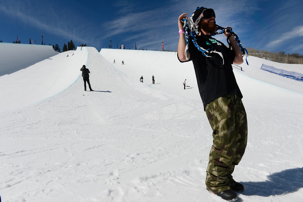 . Professional snowboarder, Scotty Lago, right, hat �dreads� in between runs during practice at the Buttermilk ski area Friday morning, March 21, 2014.  (Photo By Andy Cross / The Denver Post)
