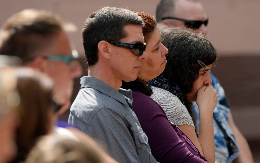 . Ron and Jennifer Nelson sit with their daughter, Becca during a memorial service for their daughter Wiyanna Nelson and Wesley Quinlan at the National Center for Atmospheric Research in Boulder, CO September 21, 2013.  (Photo By Craig F. Walker / The Denver Post)