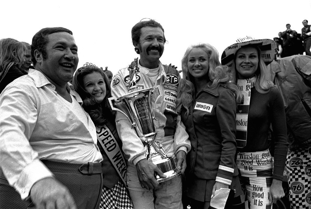 . Richard Petty of Randleman, N.C., poses with his trophy in the victory circle after he won the Daytona 500 race February 18, 1973 for the fourth time.  (AP Photo)