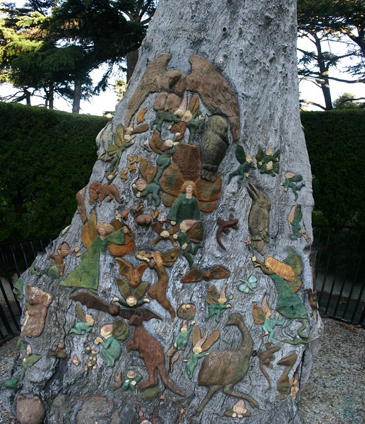 a tree with ornate sculptures