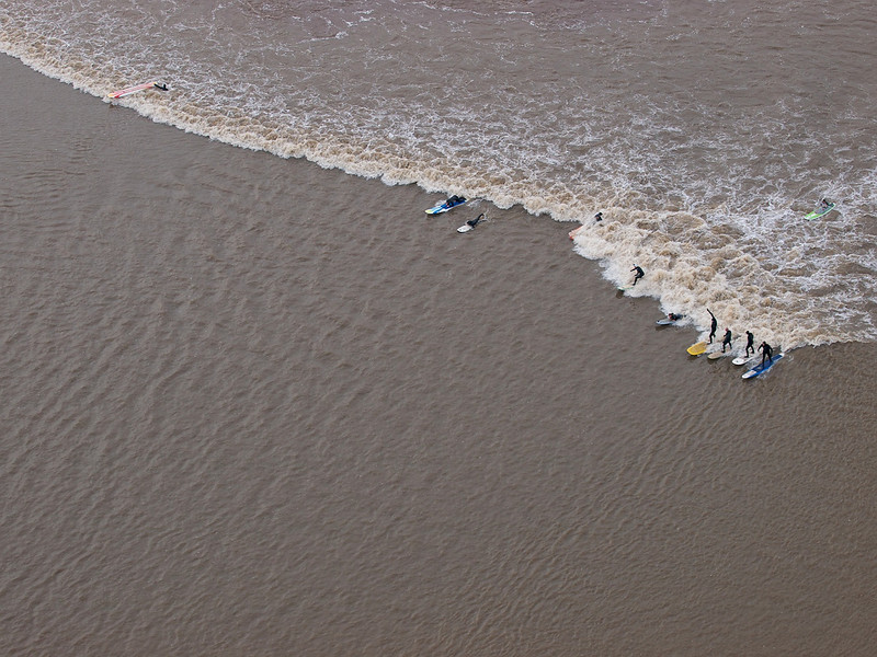 A group of surfers enjoying lower section of the river.
