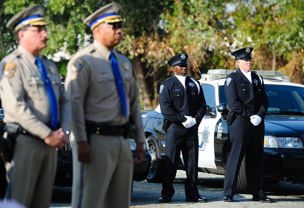 . San Bernardino police and CHP officers listen to a 9/11 remembrance ceremony at the Public Safety Academy in San Bernardino on Wednesday, Sept. 11, 2013. (Photo by Rachel Luna / San Bernardino Sun)