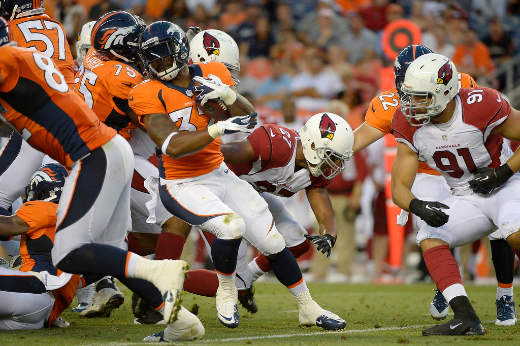 . Jeremiah Johnson (37) of the Denver Broncos gets tangled up behind the line of scrimmage before scrambling for a short gain against the Arizona Cardinals during the last pre-season game of the season at Sports Authority Field at Mile High. August 29, 2013 Denver, Colorado. (Photo By Joe Amon/The Denver Post)