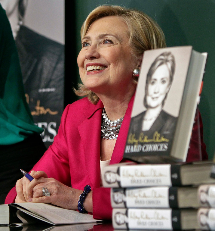 ". HiIlary Rodham Clinton listens before signing a copy of her book, ""Hard Choices\"" on Tuesday June 10, 2014, at Barnes and Noble bookstore in New York.    (AP Photo/Bebeto Matthews)"
