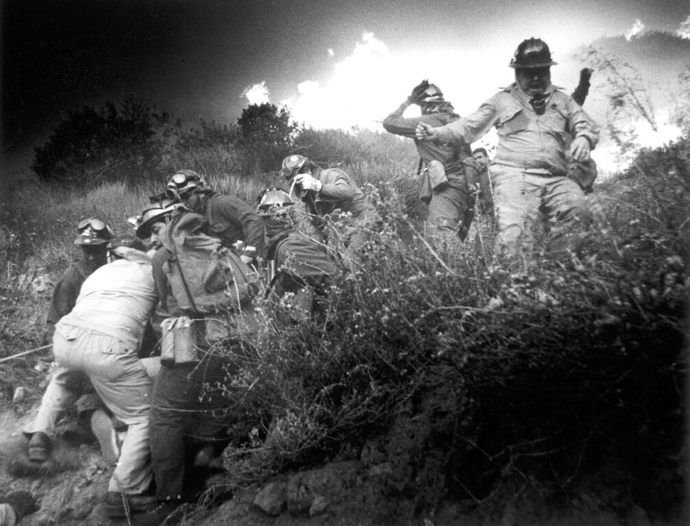 . Lori Shishino and Lee Brooks rescued by firefighters after they went up into the mountains to chase their dog. (11/2/93)   Los Angeles Daily News file photo