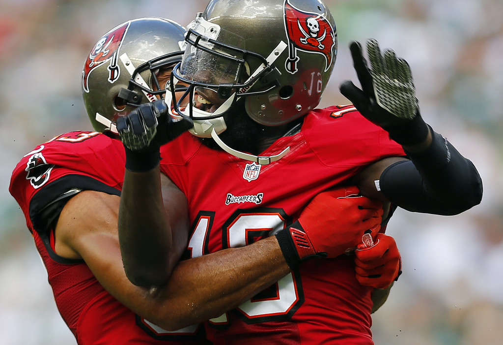 . Wide receiver Mike Williams #19 celebrates his first quarter touchdown with teammate wide receiver Vincent Jackson #83 against the New York Jets at MetLife Stadium on September 8, 2013 in East Rutherford, New Jersey. (Photo by Rich Schultz /Getty Images)