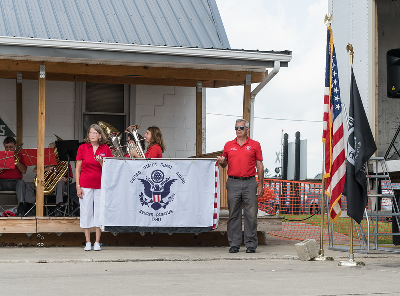 Vicki and Ron did the honors with service flags