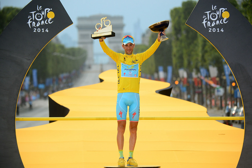 . Tour de France 2014\'s winner Italy\'s Vincenzo Nibali poses on the podium on the Champs-Elysees avenue in Paris, at the end of the 137.5 km twenty-first and last stage of the 101st edition of the Tour de France cycling race on July 27, 2014 between Evry and Paris.   JEROME PREVOST/AFP/Getty Images