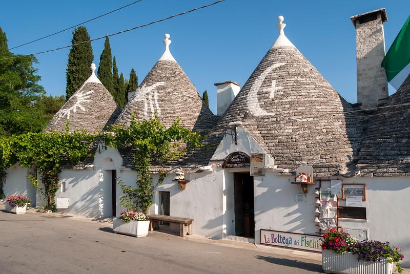 Row of Trullo Houses in Monte Pertica Street, Alberobello Trulli, Puglia, Italy