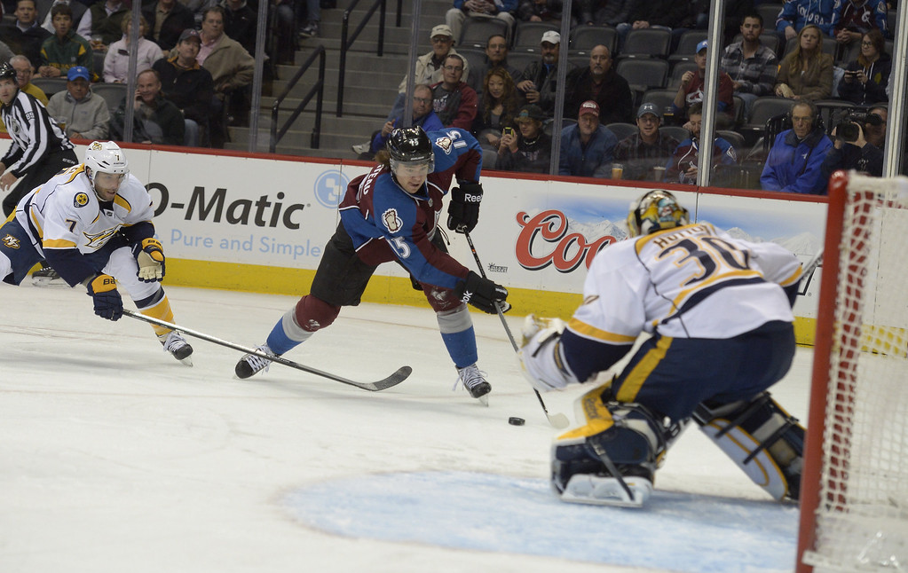 . The Colorado Avalanche PA Parenteau (15) skates toward the puck to take a shot on Nashiville Predators G Carter Hutton (30) during the frirst period November 6, 2013 at Pepsi Center. (Photo by John Leyba/The Denver Post)