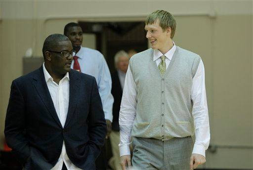 . Detroit Pistons president of basketball operations Joe Dumars walks with draft pick Kyle Singler at the team\'s practice facility in Auburn Hills, Mich., Saturday, June 25, 2011. (AP Photo/Carlos Osorio)