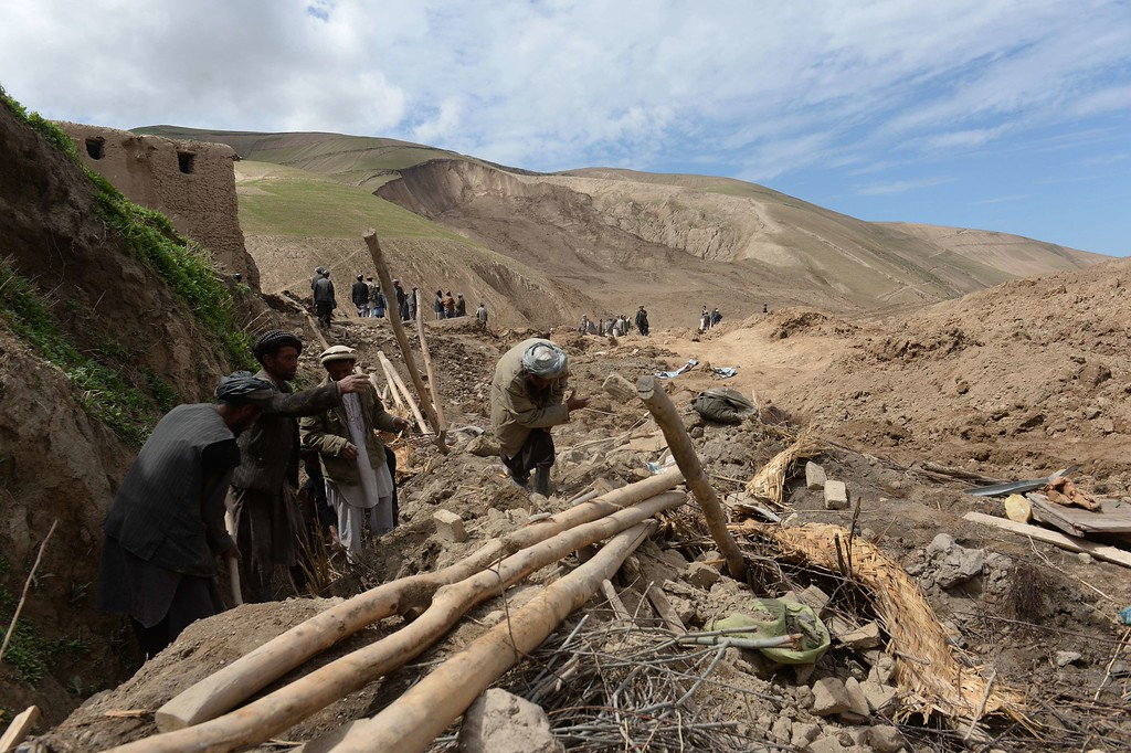 . Afghan villagers search through debris at the scene in the landslide-hit Aab Bareek village in Argo district of Badakhshan on May 5, 2014. AFP PHOTO/SHAH  MARAI/AFP/Getty Images