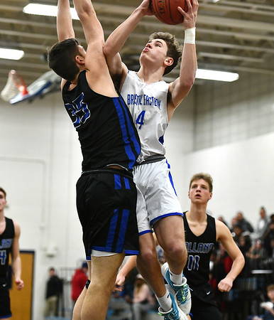 2/18/2020 Mike Orazzi | StaffrBristol Eastern High School's Bryce Curtin (4)and Tolland's Tim Restall (35) in Bristol on Tuesday night.