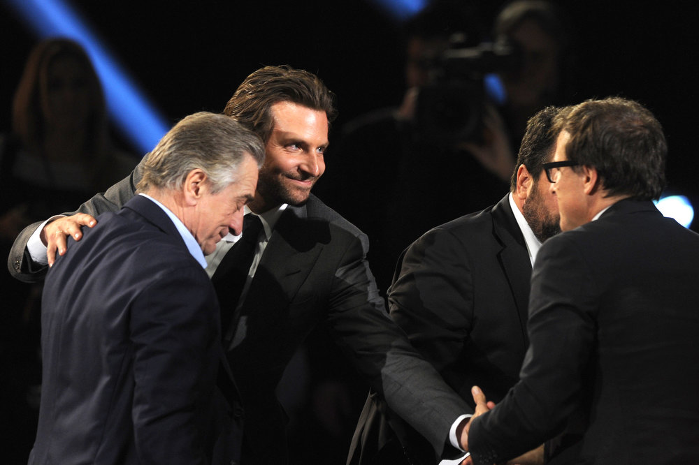 Description of . (L-R) Actors Robert De Niro, Bradley Cooper and writer/director David O. Russell onstage at the 18th Annual Critics' Choice Movie Awards held at Barker Hangar on January 10, 2013 in Santa Monica, California.  (Photo by Kevin Winter/Getty Images)