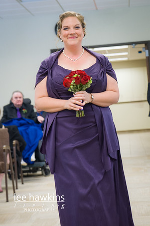 Bridesmaid walking up the aisle during wedding ceremony