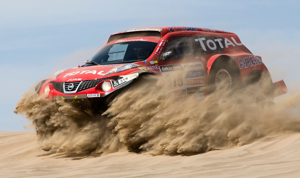 . Christian Lavieille and co-driver Jean-Michel Polato of France compete in the 1st stage of the 2013 Dakar Rally near Pisco, Peru, Saturday, Jan. 5, 2013. The race finishes in Santiago, Chile, on Jan. 20. (AP Photo/Victor R. Caivano)