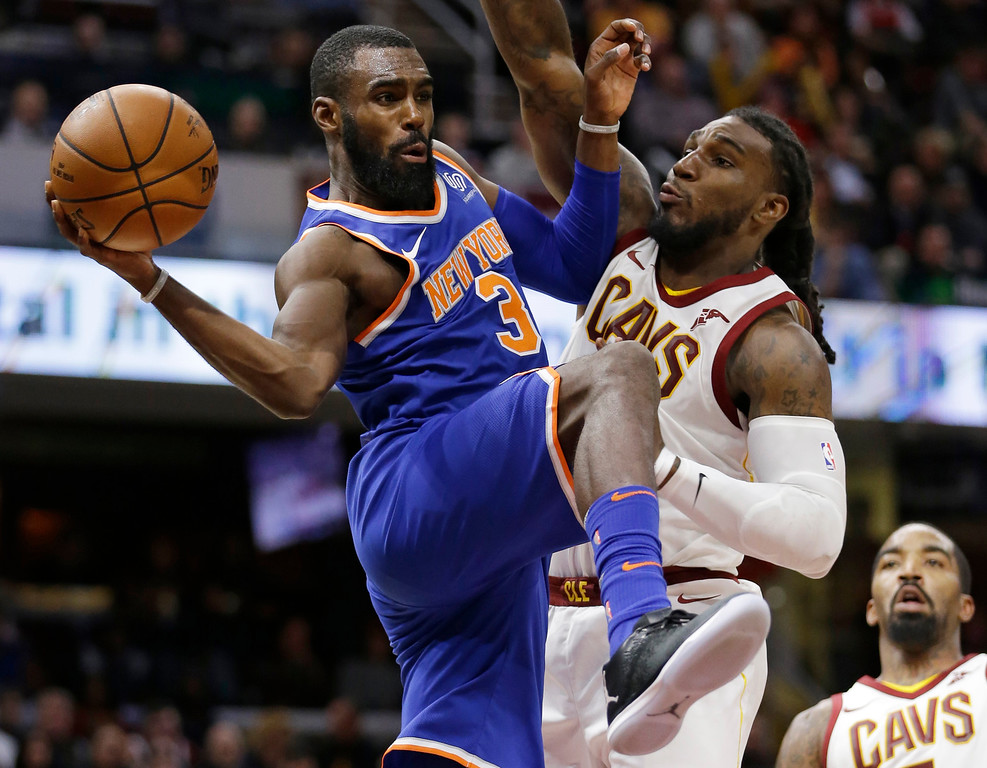. New York Knicks\' Tim Hardaway Jr., left, passes around Cleveland Cavaliers\' Jae Crowder in the second half of an NBA basketball game, Sunday, Oct. 29, 2017, in Cleveland. The Knicks won 114-95. (AP Photo/Tony Dejak)