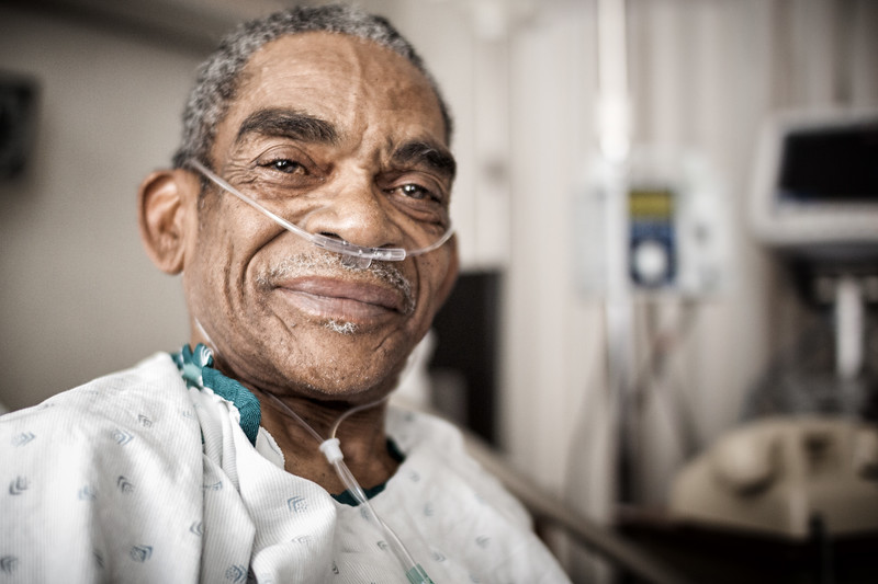 Hopeful elderly man wearing oxygen tube