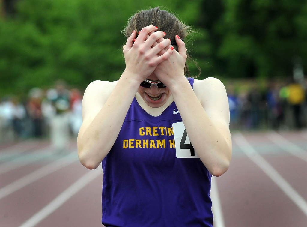 . Megan Linder of Cretin-Derham Hall reacts after placing first in the 400 meter dash. (Pioneer Press: Sherri LaRose-Chiglo)