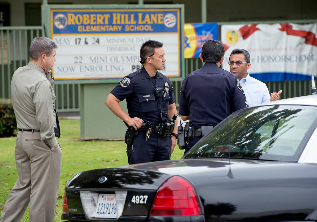 . Los Angeles School Police lockdown Robert Hill Lane Elementary School on Cesar Chavez Avenue across from East Los Angeles Community College after a man threatened to shoot up that campus as well as Santa Monica Community College May 16, 2013.   (SGVN/Staff photo by Leo Jarzomb)