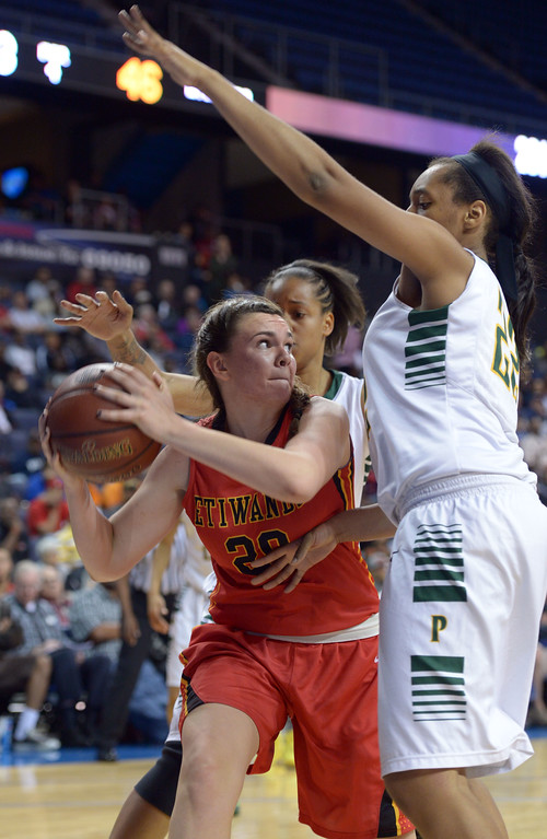 . Poly defenders put pressure on Etiwanda\'s Alyssa Anderson at Citizens Business Bank Arena in Ontario, CA on Saturday, March 22, 2014. Long Beach Poly vs Etiwanda in the CIF girls open division regional final. 2nd half, Poly won 56-46. Photo by Scott Varley, Daily Breeze)