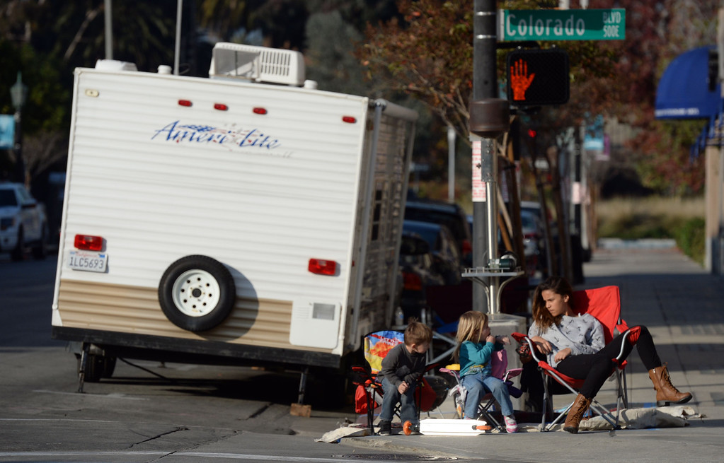. People camp out and stake their spots for the Rose Parade along Colorado Boulevard in Pasadena, Calif., on Tuesday, Dec. 29, 2013.     (Keith Birmingham Pasadena Star-News)